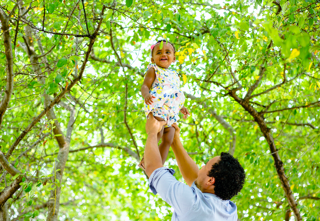Father holding daughter in the air